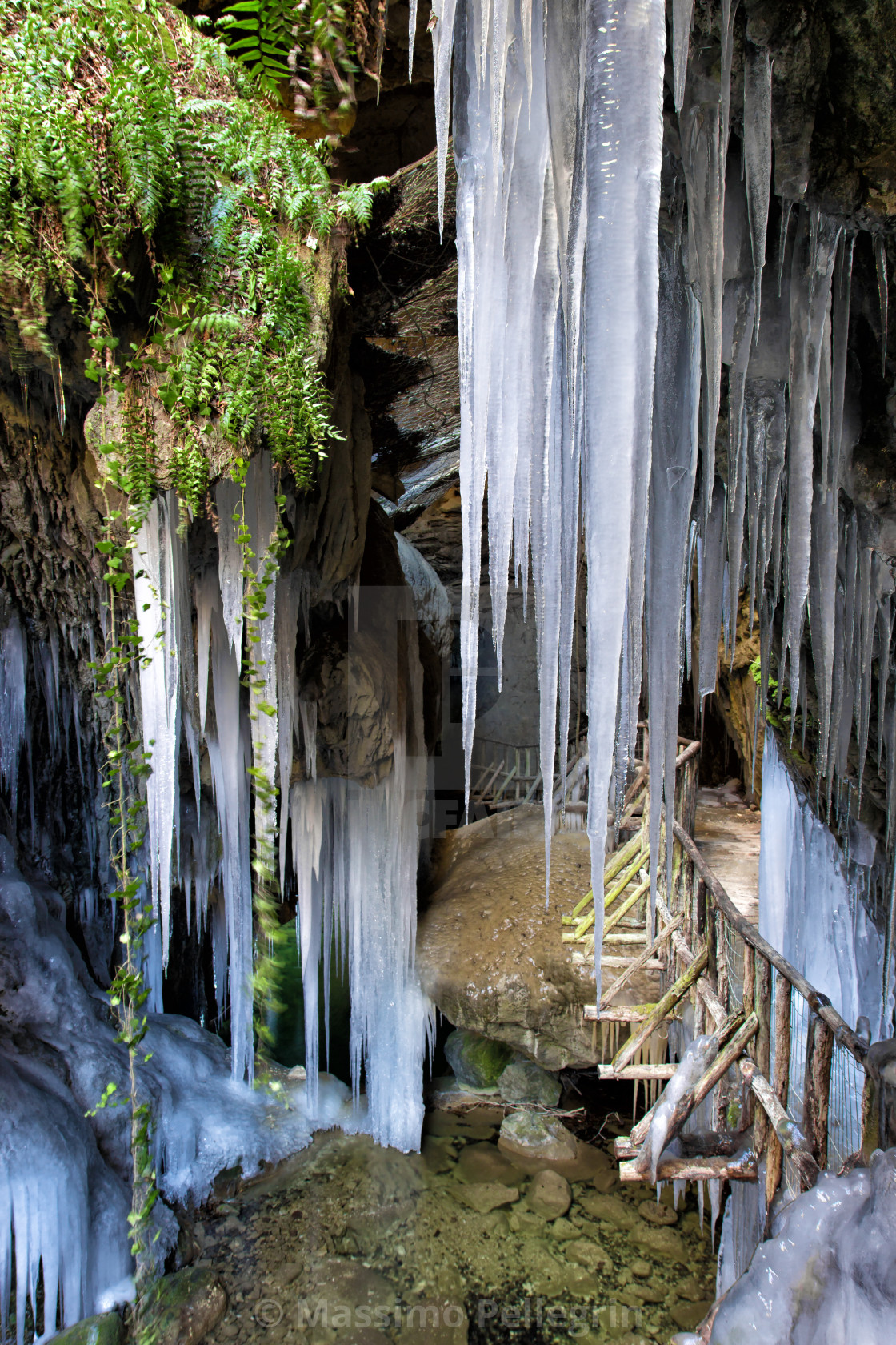 """View of stalactites and stalagmites of ice at the entrance of a cave"" stock image"