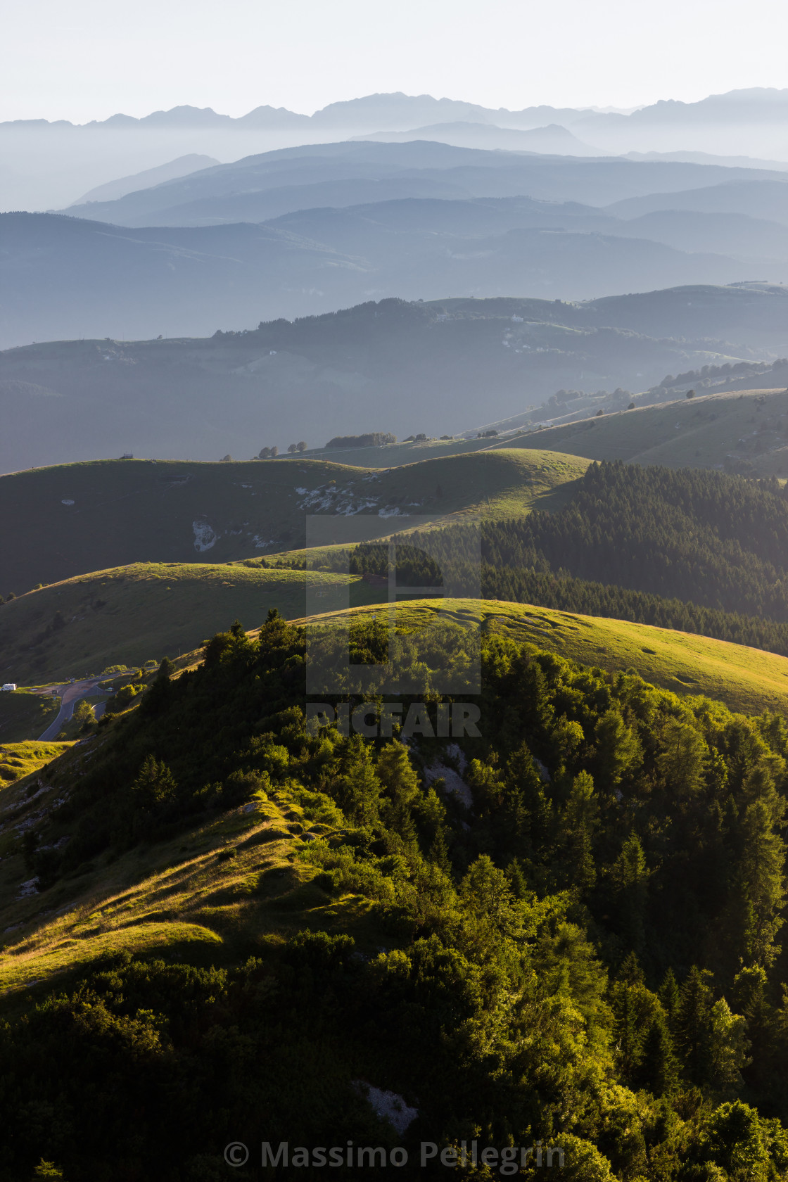 """Panoramic view of mountains in the mist"" stock image"