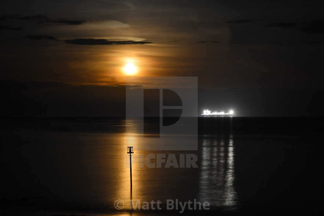 """Full Moon and Ship in the Bay"" stock image"
