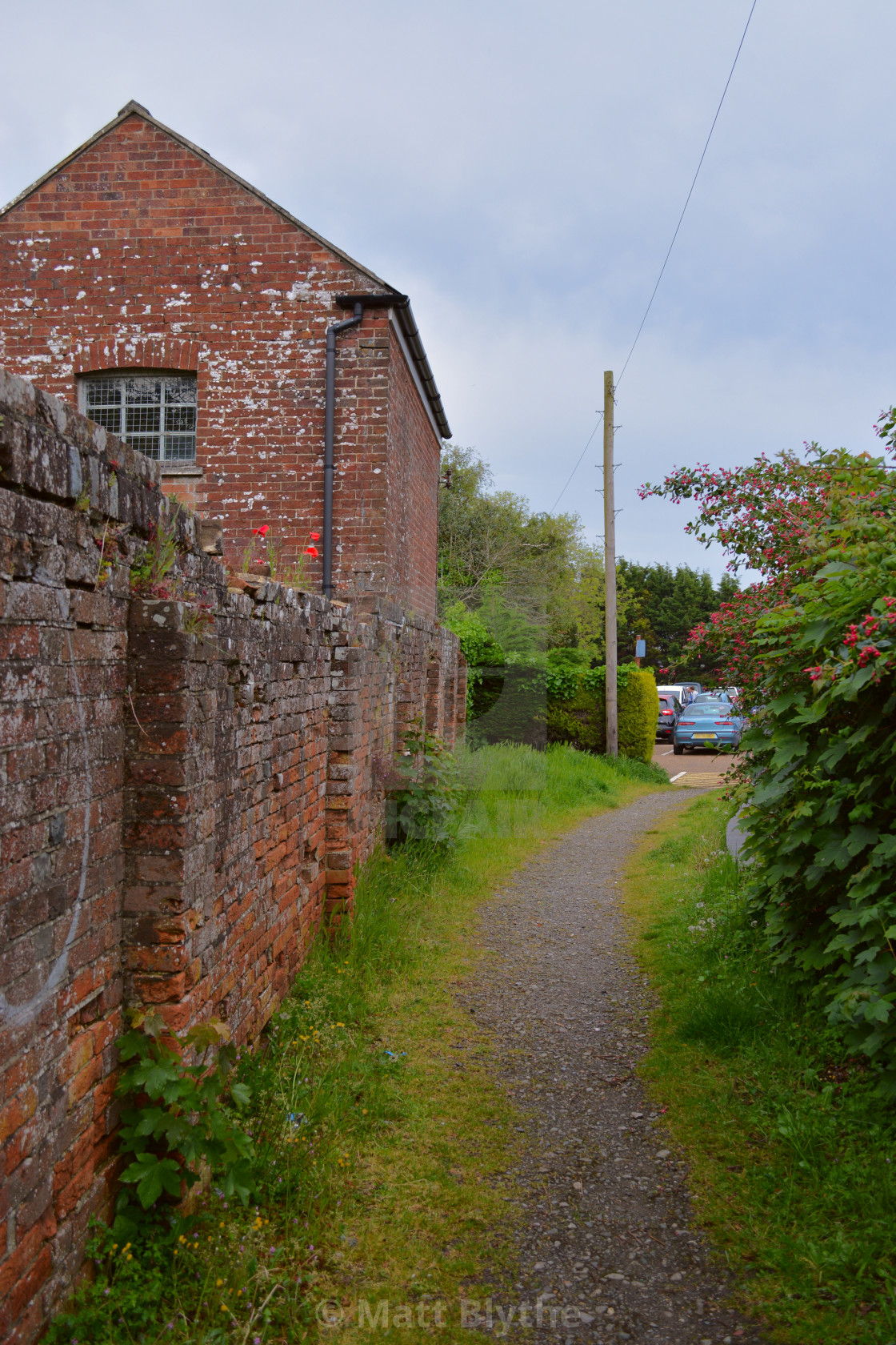 """Footpath and Old Red Brick Building"" stock image"