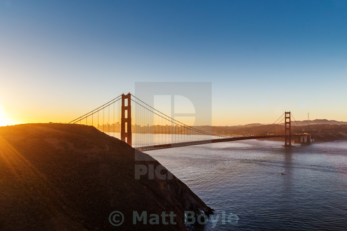 """A view of the Golden Gate Bridge at sunrise"" stock image"
