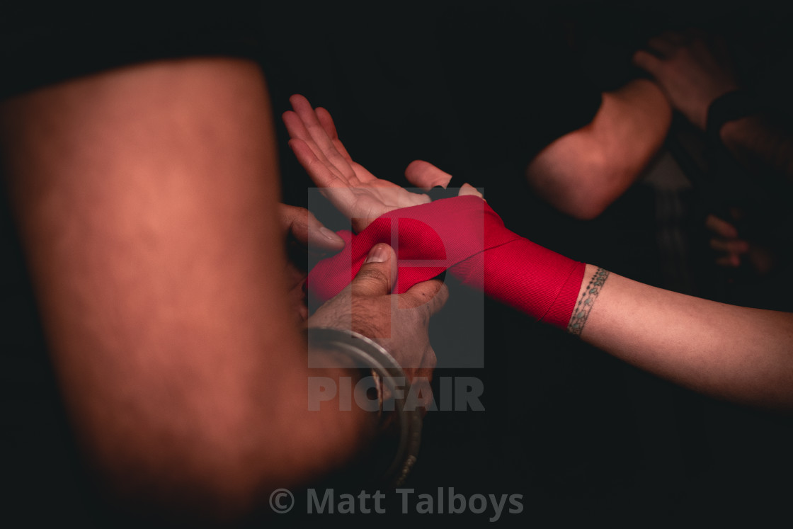 """Boxer wrapping his hands before a bout"" stock image"