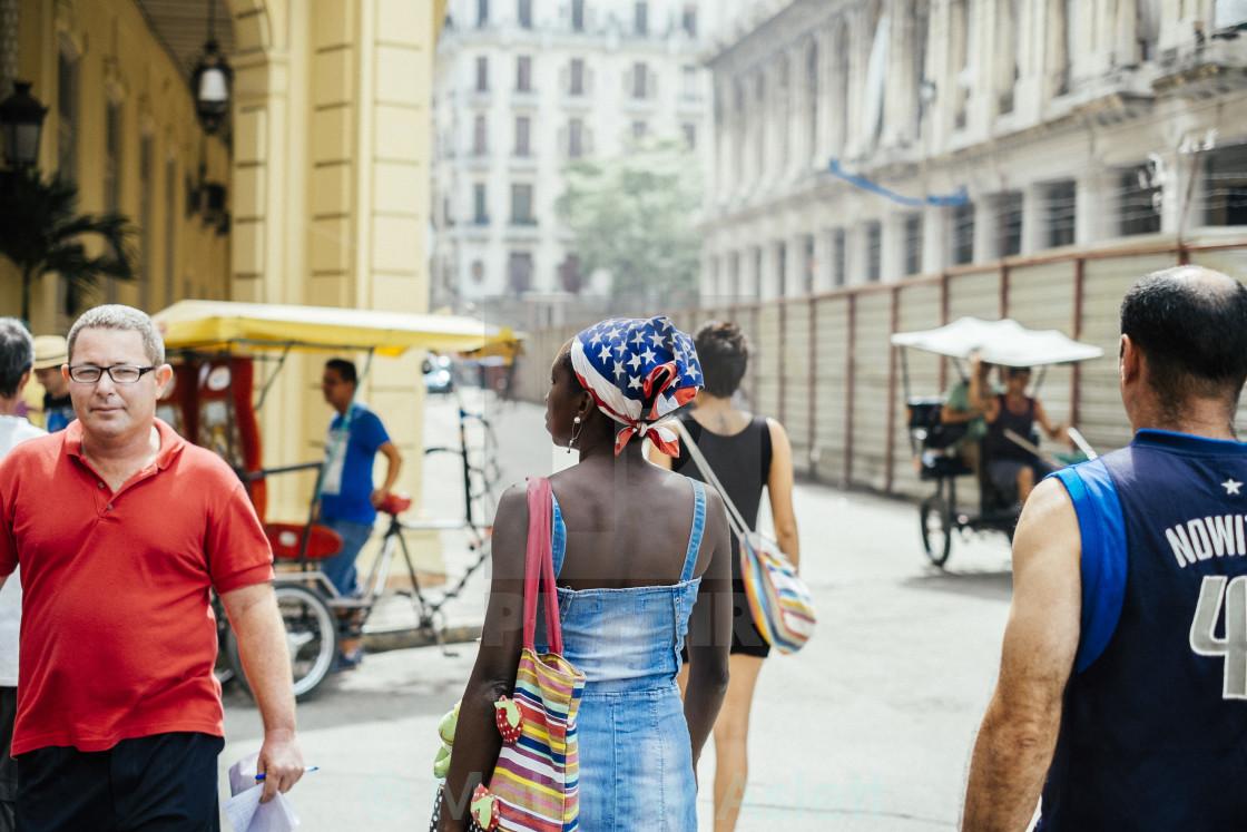 """A women with an American flag head scarf in Havana Cuba"" stock image"