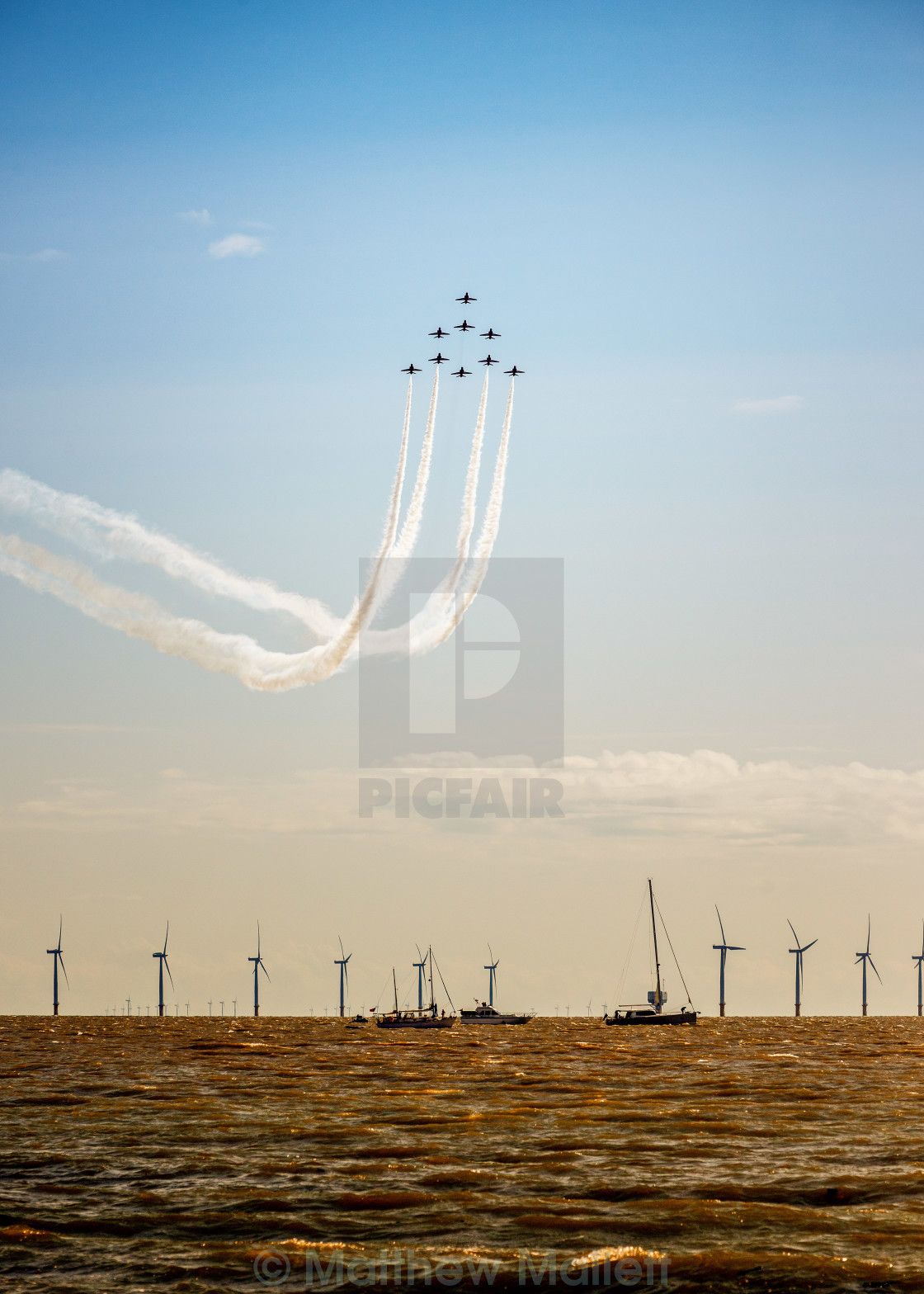 """Red Arrow Formation Over Gunfleet Windfarm"" stock image"