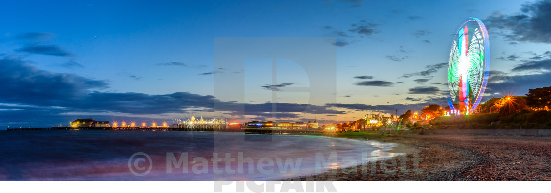 """Clacton Pier and Pavilion at Dusk"" stock image"