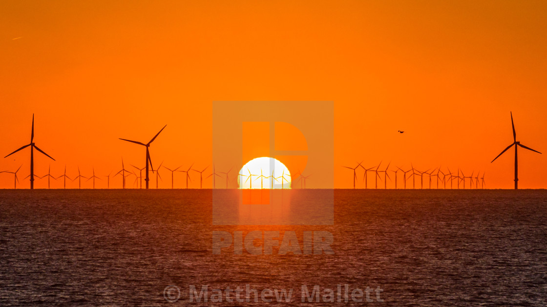 """Boiling Sunrise Over Clacton Windfarm"" stock image"