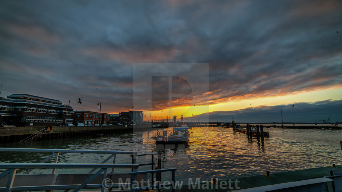 """Winter Sunset At Hapenny Pier Harwich"" stock image"