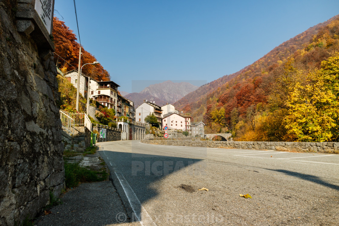 """Rustic alpine village in autumn scenery"" stock image"