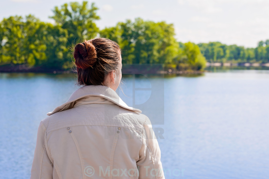 """Woman Looking at the River"" stock image"