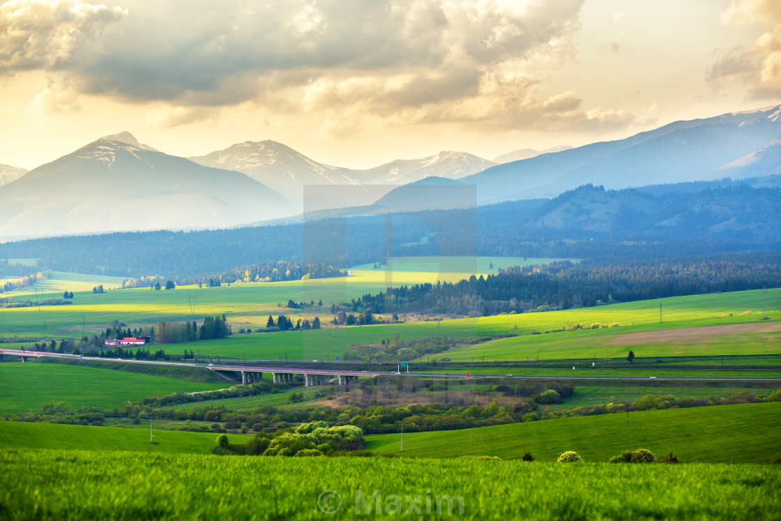 """Picturesque green fields and meadow landscape. Spring mountain v"" stock image"