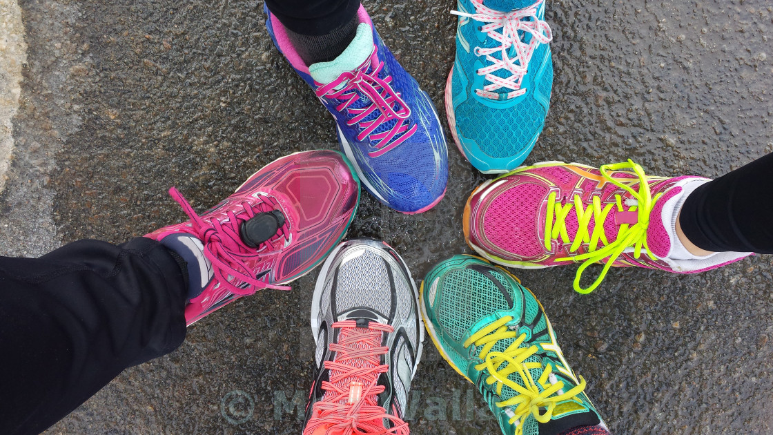 """Overhead view of running shoes"" stock image"