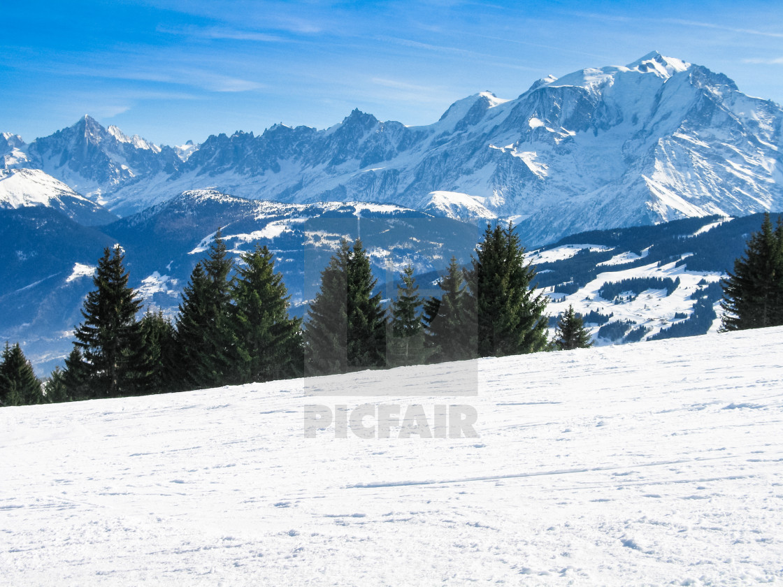 """Ski slope on Combloux ski resort with Mont Blanc in the distance, French Alps Haut Savoie, France"" stock image"