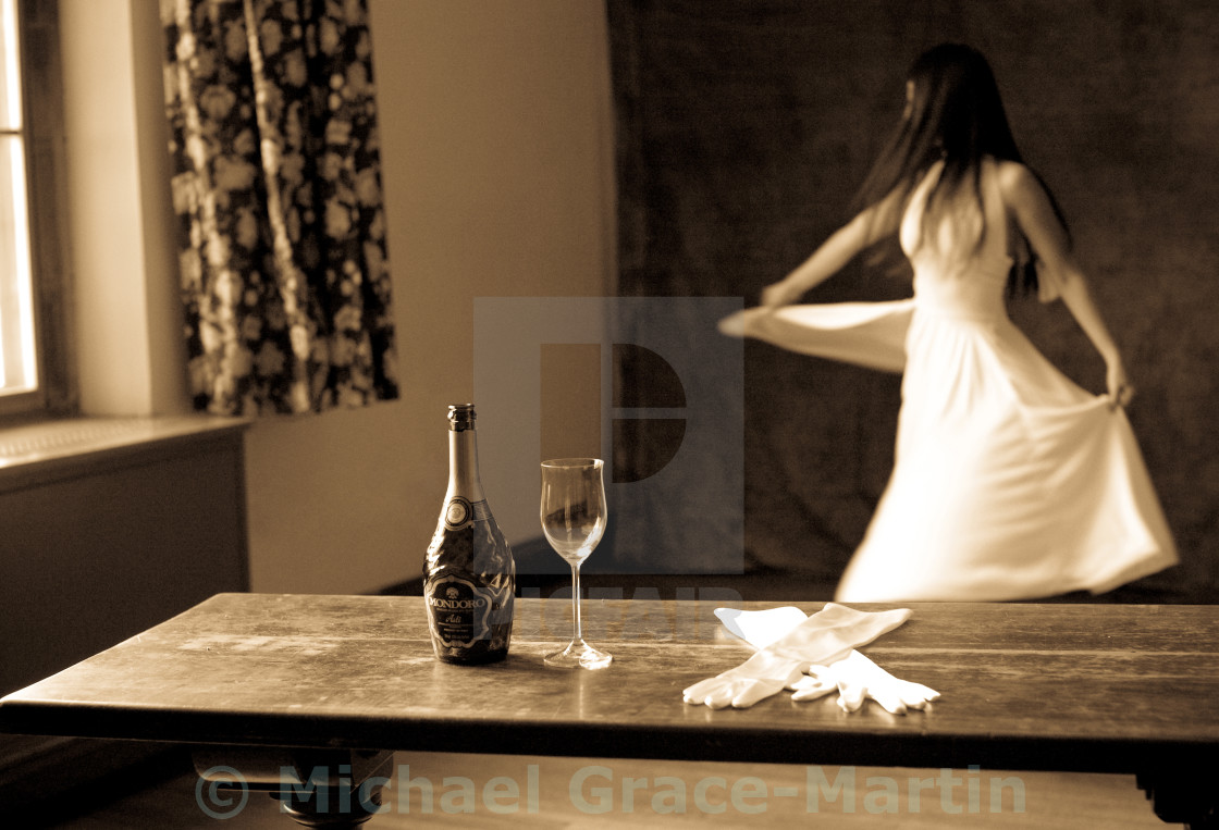 """""""Woman Dancing in White Dress with Champagne"""" stock image"""