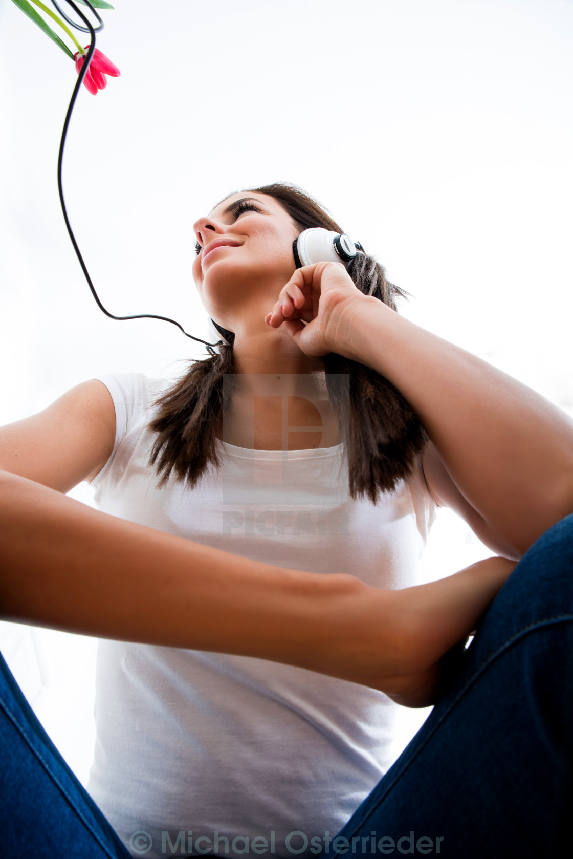 """""""Young beautiful woman listening to audio"""" stock image"""
