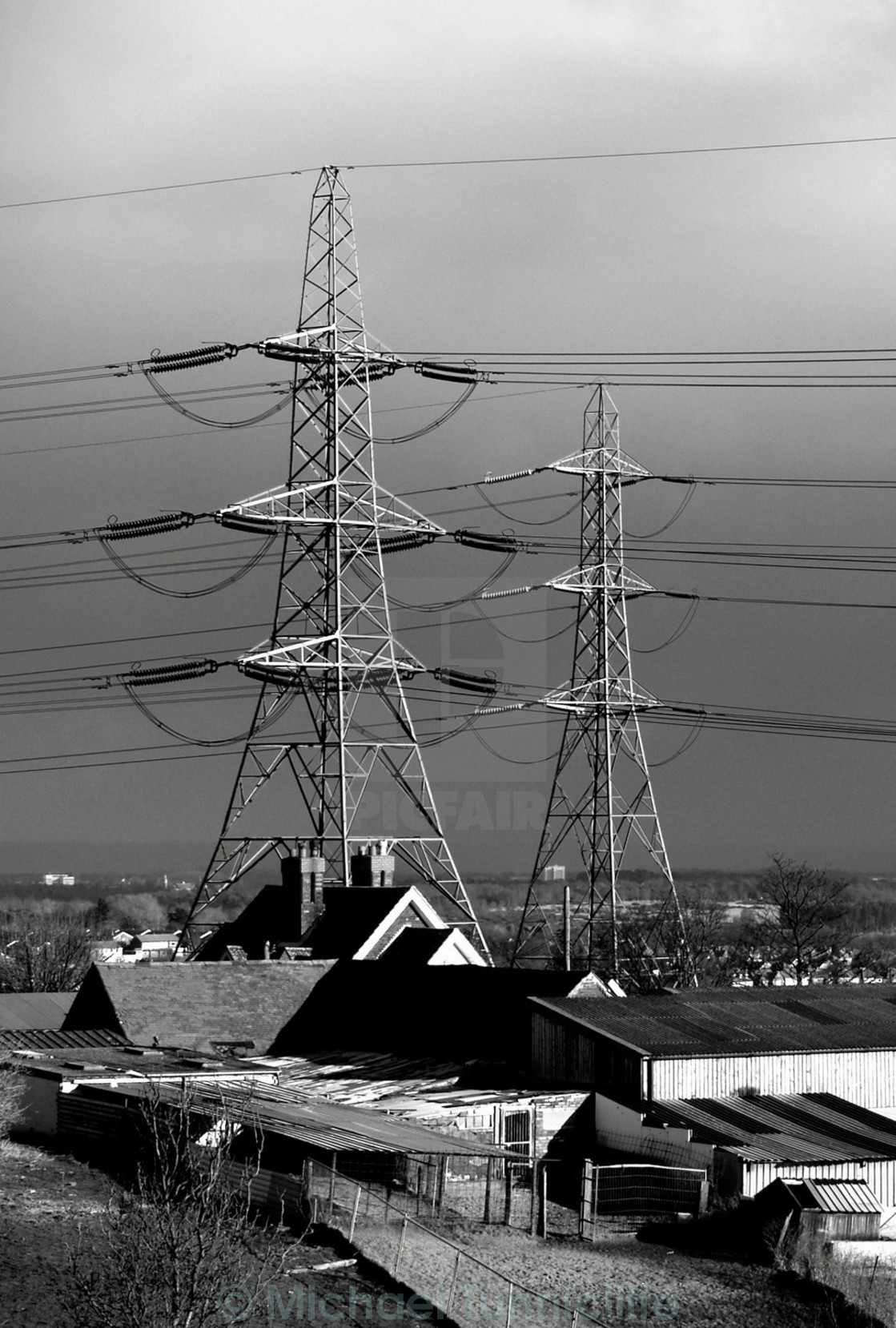 """farm overshadowed by pylons"" stock image"