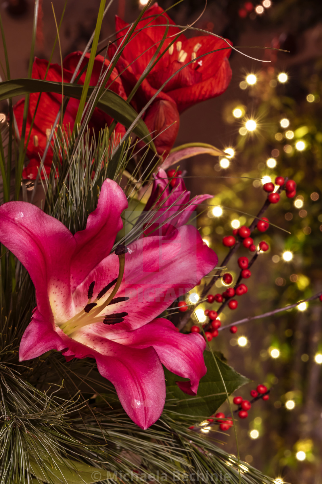 Closeup image of a bouquet of pink lilies (Lilium), branches