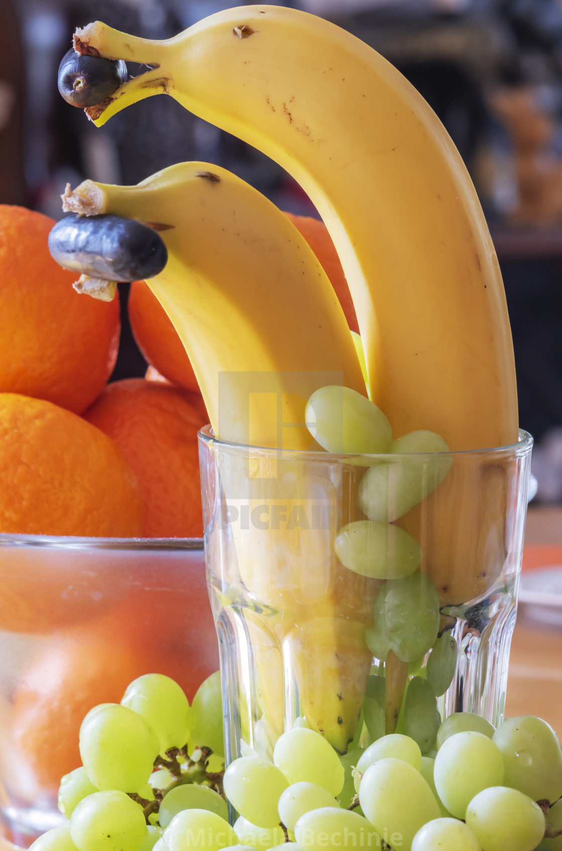 Fun food as a healthy snack with fruits: bananas as dolphins with a ...