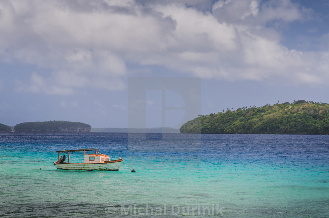 """boat at the white sand beaches in the kingdom of Tonga"" stock image"