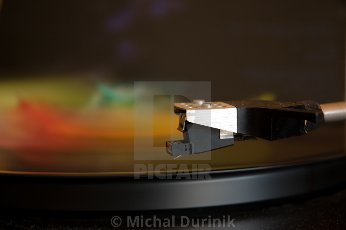 """70's model turntable playing colourful music"" stock image"