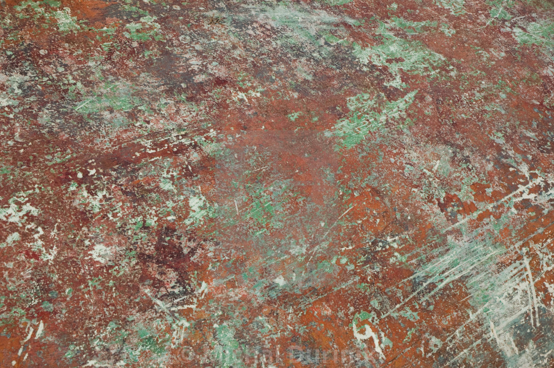 """detail of red-green worn down boat painting"" stock image"