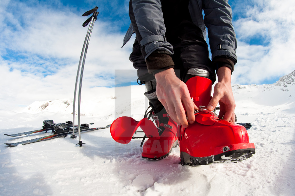 """getting ready for skiing - fastening the boots"" stock image"