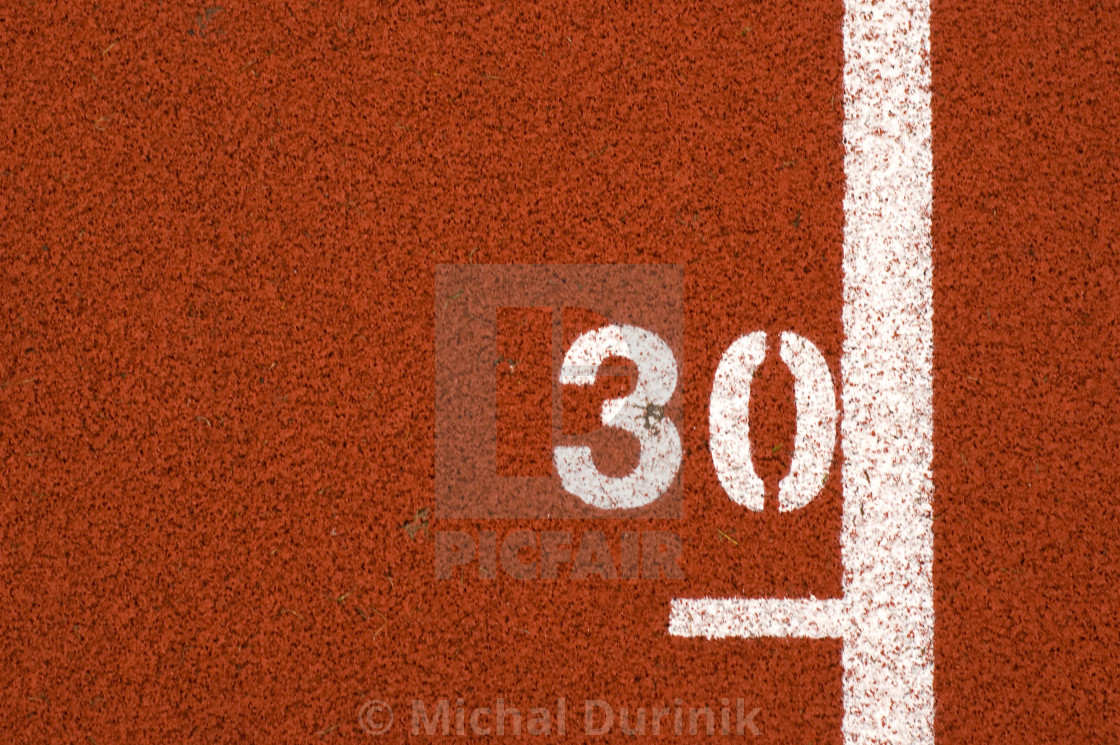 """""30"" mark on running track"" stock image"
