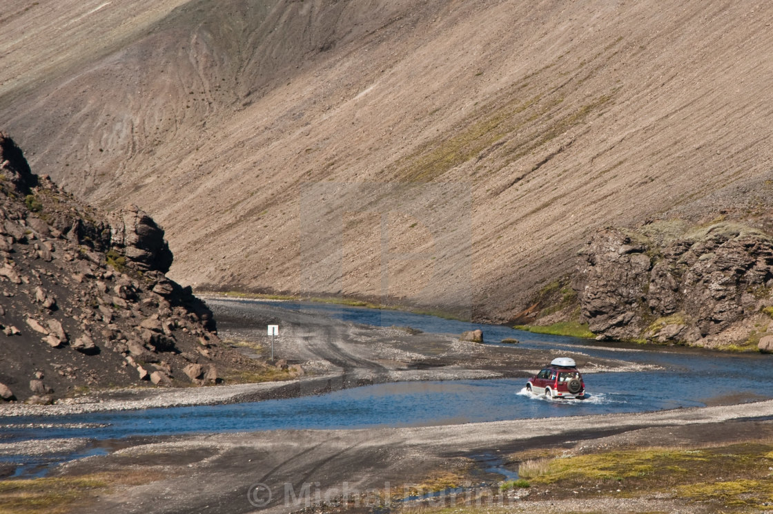 """crossing the river with off road car"" stock image"