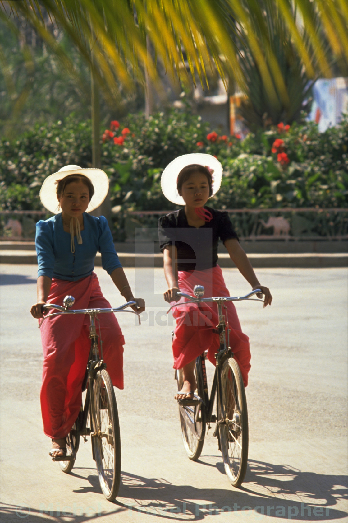 """Dai Girls Cycling in Xishuangbanna"" stock image"
