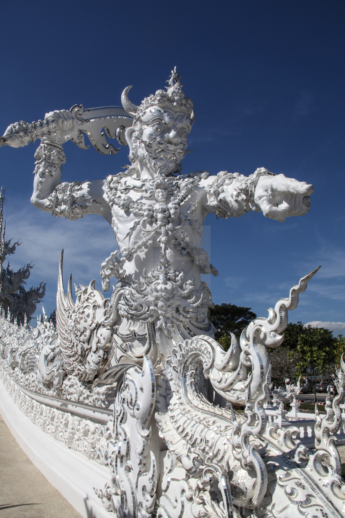 """Mythological Statue at entrance of White Temple"" stock image"