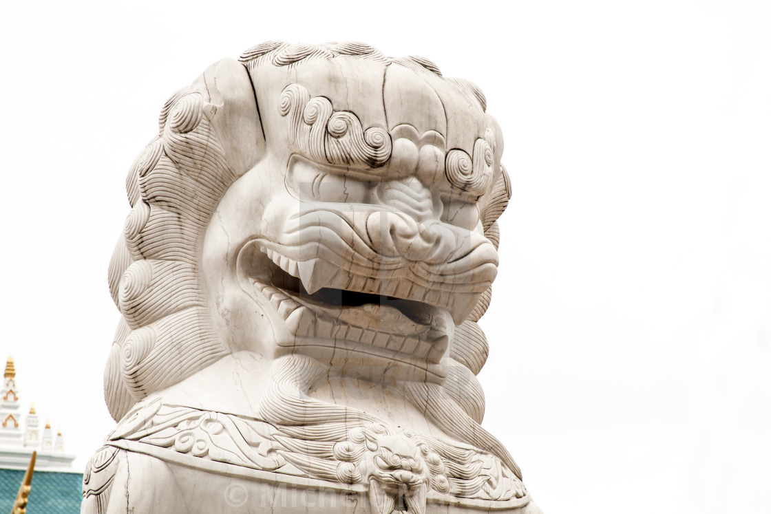 """Mythological Lion statue protecting Buddhist Temple"" stock image"