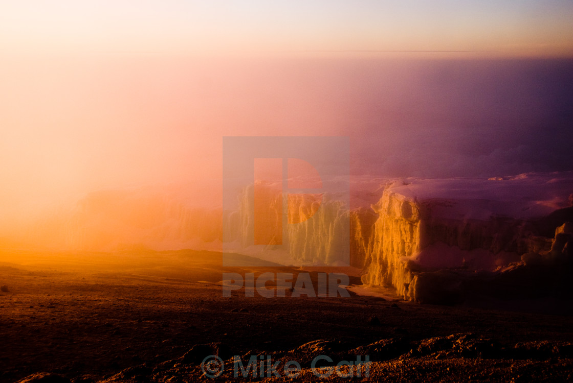 """Glacier washed in golden sunrise glow"" stock image"