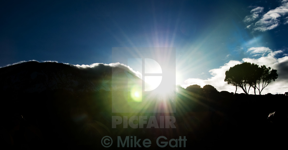 """Lens flares on Mt Kilimanjaro"" stock image"