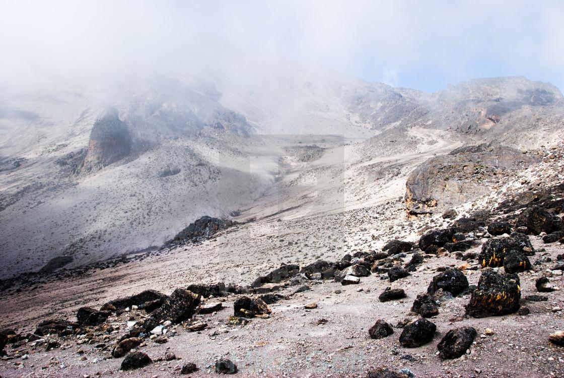 """Alpine desert shrouded in cloud"" stock image"