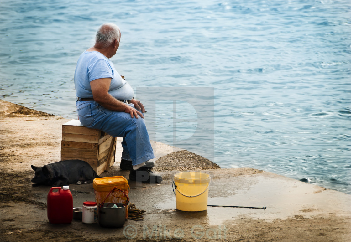 """Old Man with his dog by the sea"" stock image"