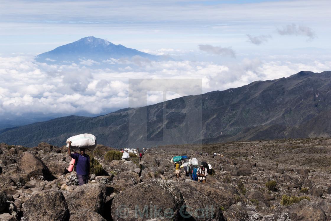 """Trail of Porters on Mt Kilimanjaro"" stock image"