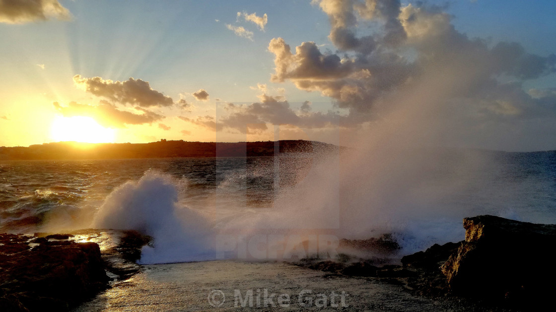 """""""Wind and surf, and a bit of sunset"""" stock image"""