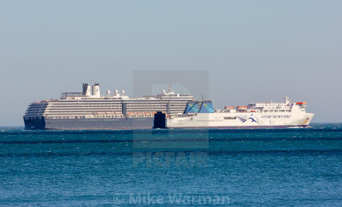 """Ferry passes cruise ship"" stock image"