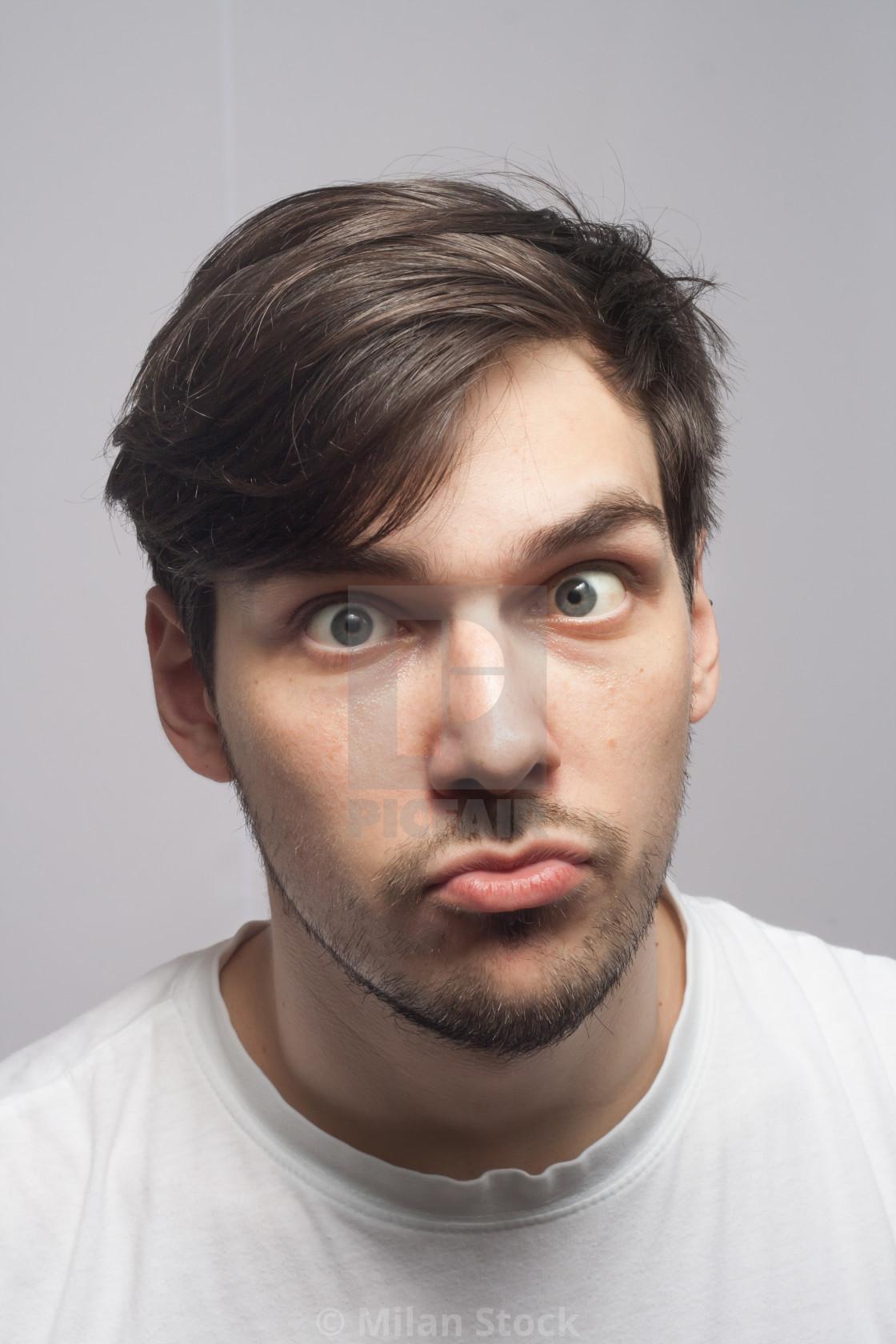 """Man portrait cross squint skew eye portrait."" stock image"