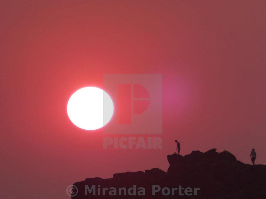 """Red Sun rising"" stock image"