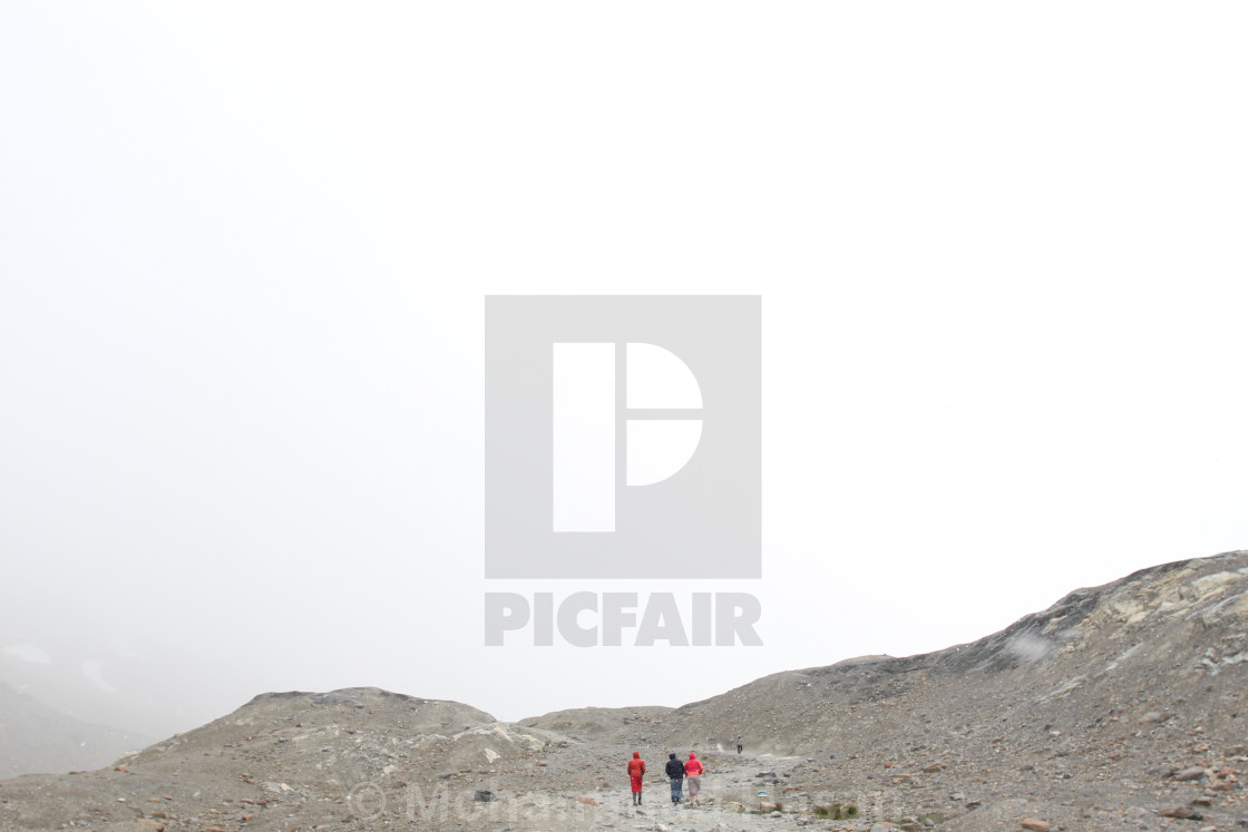 """Travelers on Athabasca Icefield"" stock image"