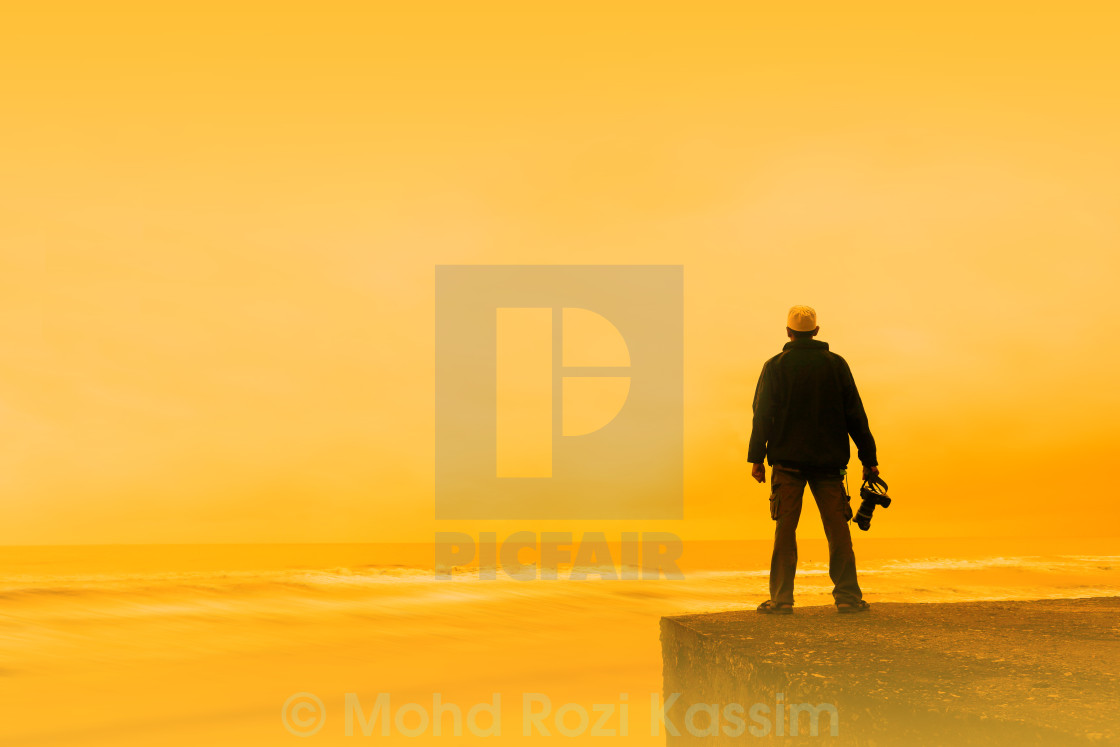 """A silhouetted photographer"" stock image"