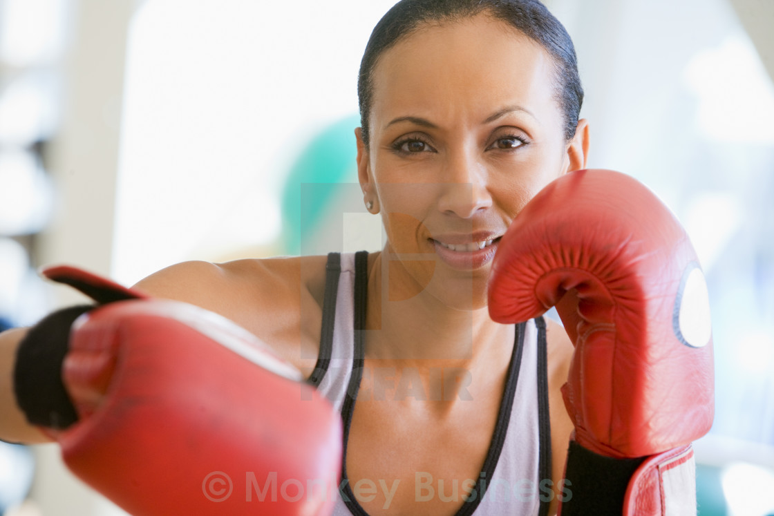 """Woman Boxing At Gym"" stock image"
