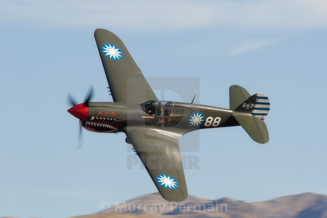 """Curtiss P40 in a banking turn"" stock image"