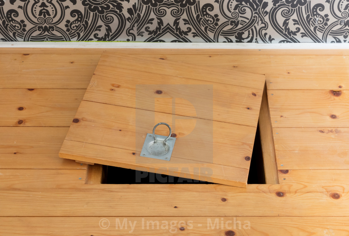 """Wooden square old hatchway in the cellar"" stock image"
