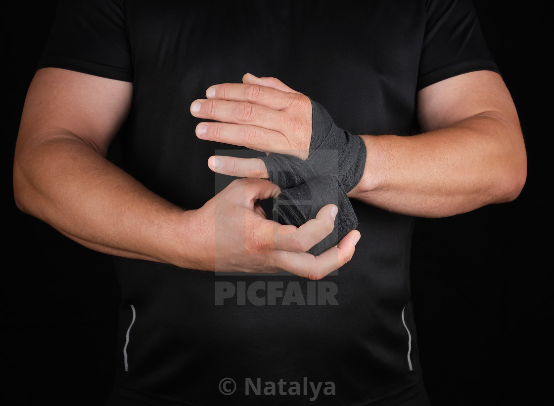 """""""athlete stand in black clothes and wrap his hands in textile ela"""" stock image"""