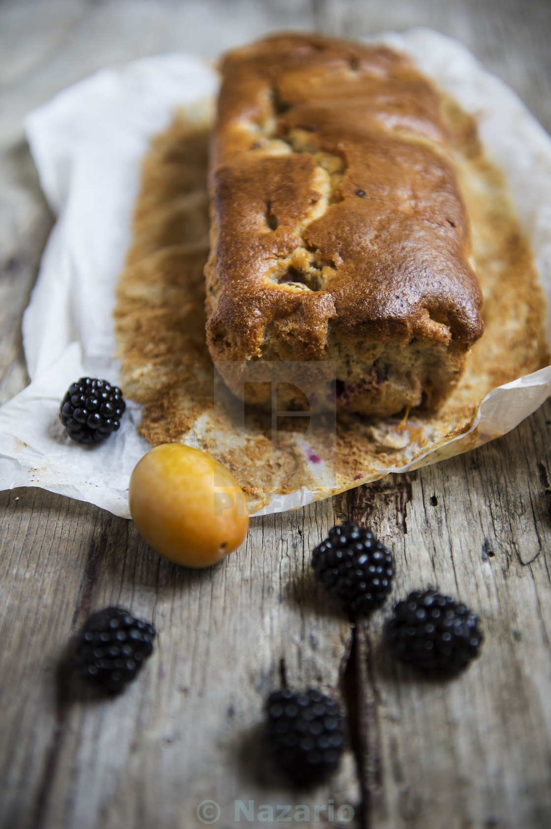 """Plumcake with plums and blackberries"" stock image"