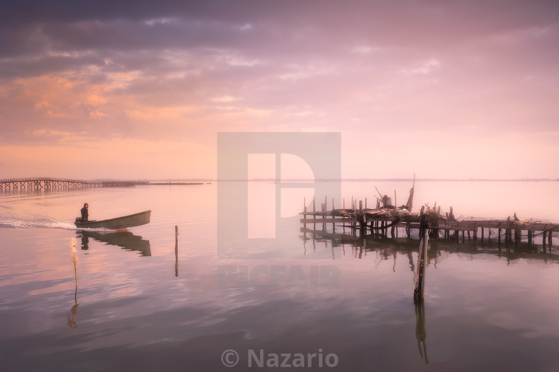 """Lesina and its lake. Fisherman in a boat."" stock image"