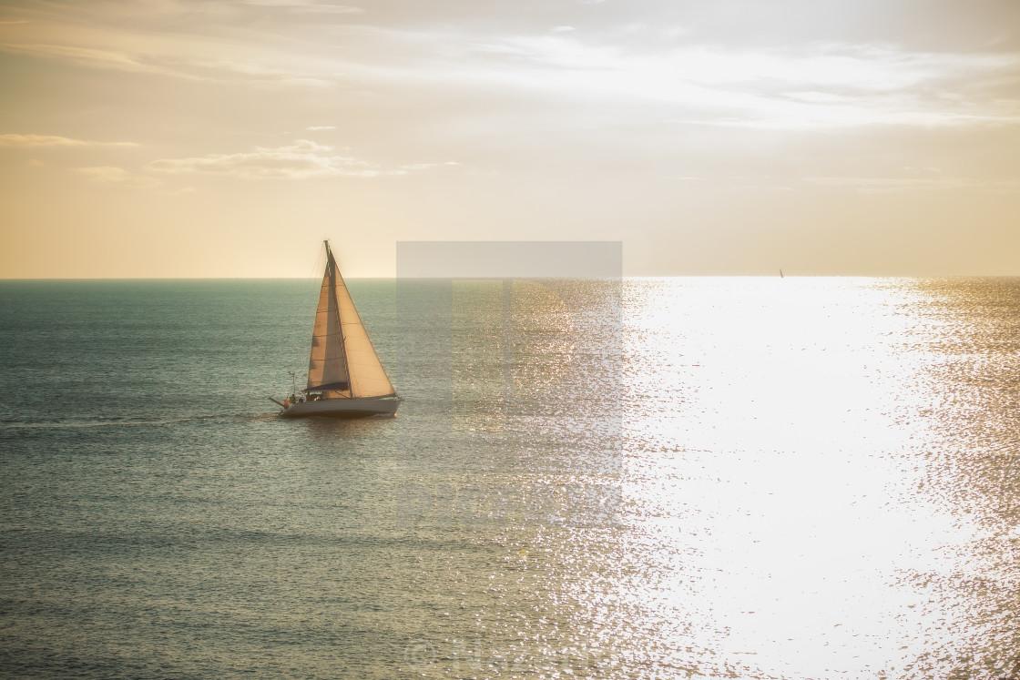 """""""Sailing towards the sun"""" stock image"""