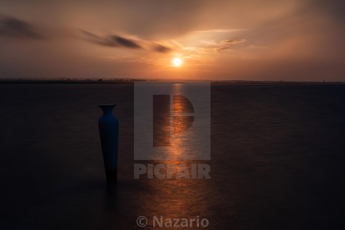 """""""Sunset on the lake of Lesina"""" stock image"""