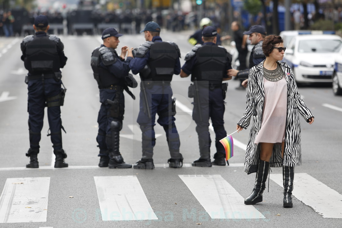 """Woman posing in front of police during Lgbt pride parade in Belgrade"" stock image"